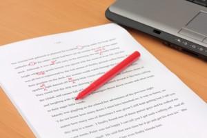 Proofreading a Manuscript beside Laptop